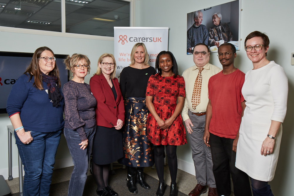 Caroline Dinenage fourth from left meets with carers and Helen Walker of Carers UK third from left